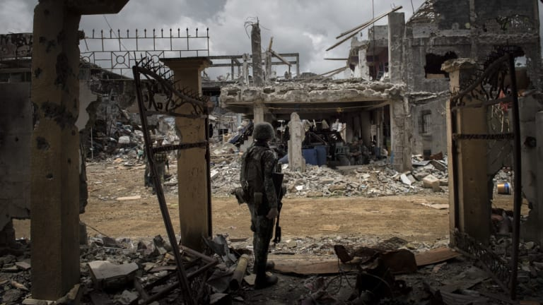 Military officials in the Philippines are blaming a spate of recent bombings on the Bangsamoro Islamic Freedom Fighters, a small but hard-line group that has aligned itself with the Islamic State group. In this photo, a soldier stands amid ruined buildings after months of fighting in Marawi against Islamic State-inspired militants.