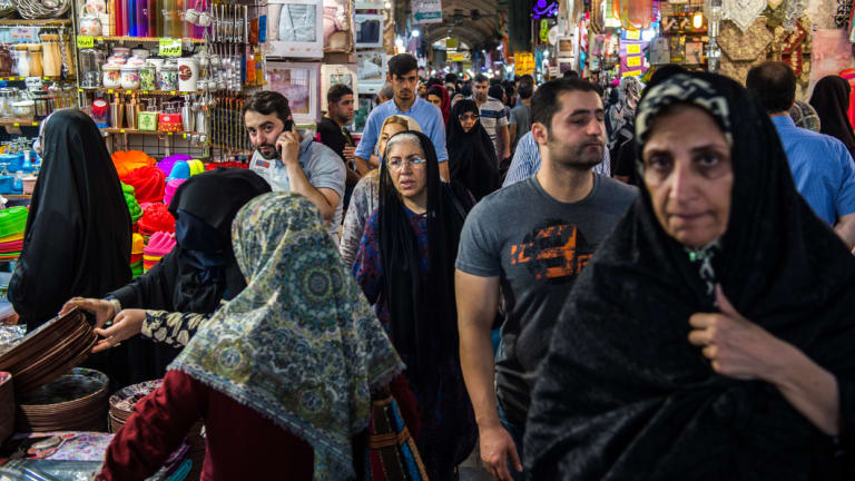 Visitors shop for goods at retail stores lining an arcade inside the Grand Bazaar in Tehran, Iran, last week.