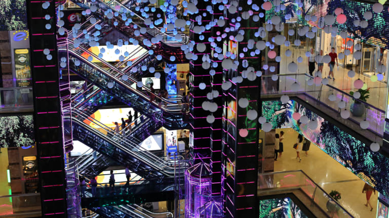 Customers shop on multiple floors at the Europeisky shopping mall in Moscow, Russia, on Friday.
