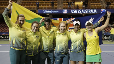 Australia enjoy their triumph over the US in the Fed Cup.