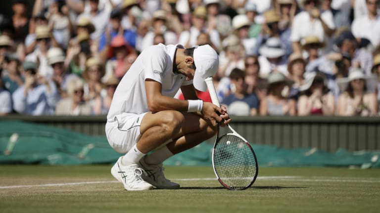Relief: Novak Djokovic drops to his haunches after winning the title.