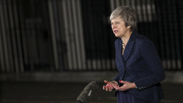 Fresh from winning a reprieve from a no confidence motion, Theresa May addresses the media.