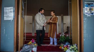 Christchurch man Paul Bradley speaks to Canberra Muslim Community president Mainul Haque at Gungahlin Mosque on Saturday.