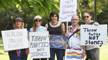 """A small group of protesters shouting """"shame Sultan, shame"""" has rallied in front of the Royal on the Park Hotel."""