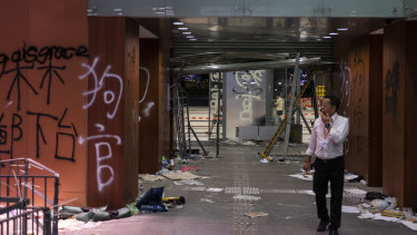 A member of staff walks past graffiti covered walls during a media tour inside Legislative Council building in Hong Kong,.