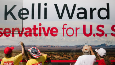 Supporters write messages on the campaign bus for Kelli Ward, Republican US Senate candidate from Arizona.