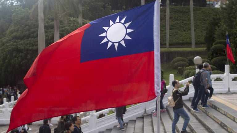 A Taiwan flag stands at the National Palace Museum in Taipei, Taiwan.