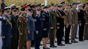 Military personnel from member states stand to attention during the NATO summit in Brussels on Wednesday.
