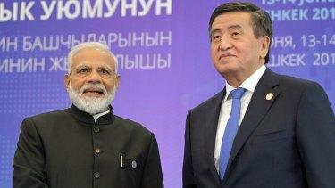 Indian Prime Minister Narendra Modi and Kyrgyzstan's President Sooronbai Jeenbekov in Shanghai in June.