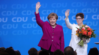 German Chancellor Angela Merkel congratulates her CDU colleague Annegret Kramp-Karrenbauer, now widely tipped as her successor.