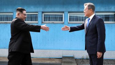 North Korean leader Kim Jong-un prepares to shake hands with South Korean President Moon Jae-in.