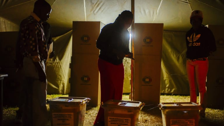 Voters cast their ballots at a polling station in the Mbaretownship, Harare.