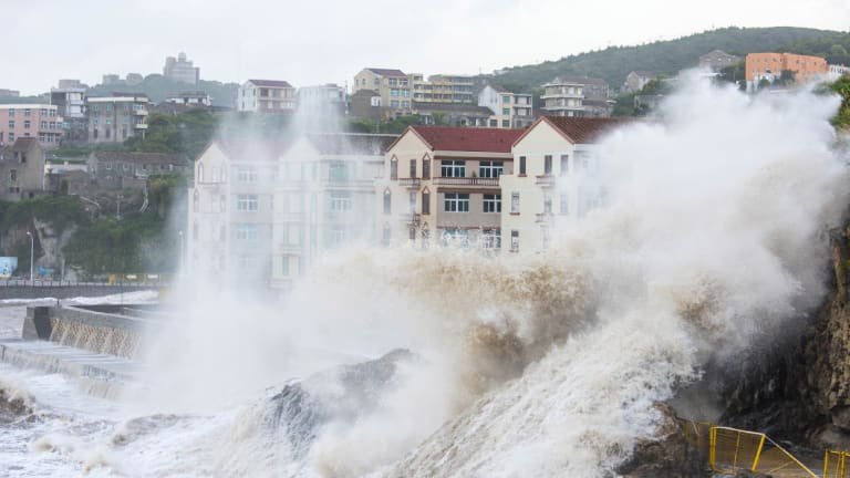 Large waves crash against the shoreline as typhoon Maria approaches Wenling city in eastern China's Zhejiang Province.