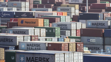 Containers sit stacked at the Yangshan Deep Water Port in Shanghai, China.