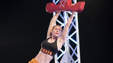 Olivia Vivian tackles the Ninja Warrior grand final course.