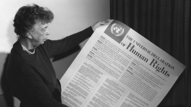 Eleanor Roosevelt holds the Universal Declaration of Human Rights.