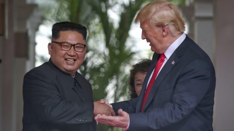 Donald Trump and Kim Jong-un shake hands in Singapore.