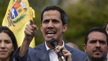 Juan Guaido, president of the National Assembly who swore himself in as the leader of Venezuela, speaks during a rally to propose amnesty laws for police and military, in the Las Mercedes neighbourhood of Caracas, Venezuela.
