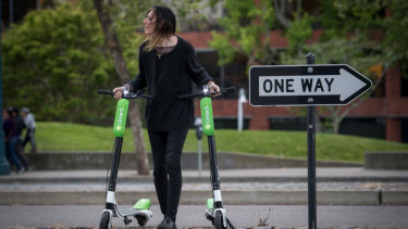 Coming to a footpath near you: Lime scooters. And possibly a pedestrian moving them.