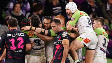 The Raiders celebrate the match-winning try over Storm.