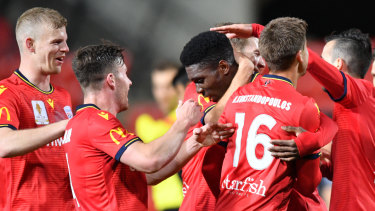 Adelaide congratulate Al Hassan Toure on his winner  against the Jets.