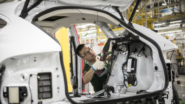 An electric vehicle (EV) being assembled at a plant in China. More than two-thirds of future demand growth for copper may come from EVs and their infrastructure.