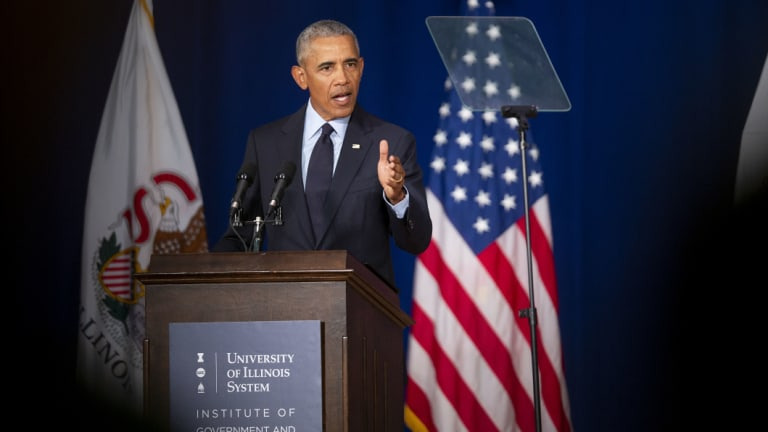Former president Barack Obama kicked off a campaign blitz against Donald Trump at the University of Illinois in Urbana, on Friday,