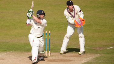 Michael Di Venuto (left), with Durham in his playing days, has coached Surrey to the English County cricket title.