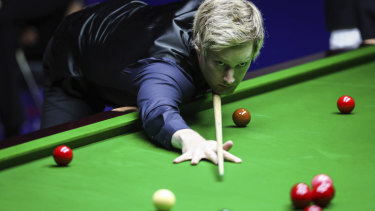 Neil Robertson of Australia at the table.