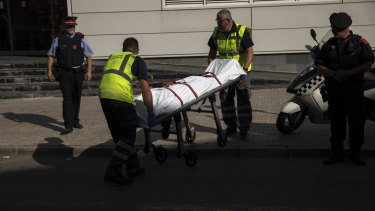 A body is taken away after an incident in the northern Spanish town of Cornella.