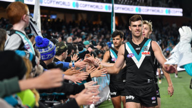 'Til next year: Scott Lycett and Port Adelaide teammates farewell fans after their win over Fremantle to end the season.