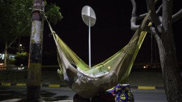 A Venezuelan migrant sleeps in a hammock at a bus terminal in Maicao, La Guajira, Colombia.