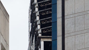 The unfinished Torre de David skyscraper in Caracas, centre, is seen leaning following the earthquake.