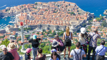 Tourists enjoy the sites of Dubrovnik, Croatia.