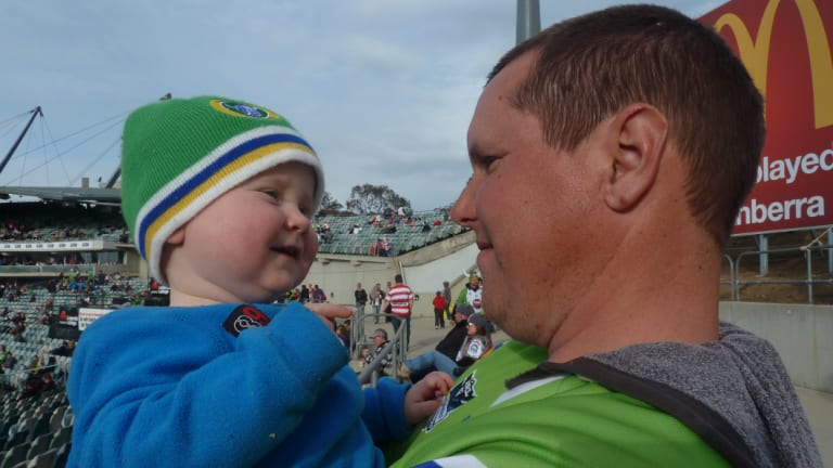 Toby Jamieson with son William at a Raiders game in 2013.