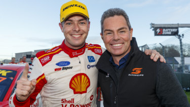Overtaking manoeuvre: Race winner Scott McLaughlin (left) is greeted by former Supercars champion Craig Lowndes after the Kiwi driver bettered Lowndes' record of most wins in a season during the ITM Auckland SuperSprint Event 11 at Pukekohe Park Raceway in New Zealand.