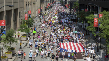 People participate in the 'Families Belong Together' march in Chicago on Saturday.