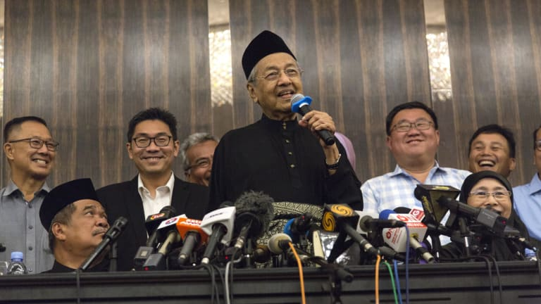 Laughter as prime minister Mahathir Mohamad addresses a news conference on Thursday.