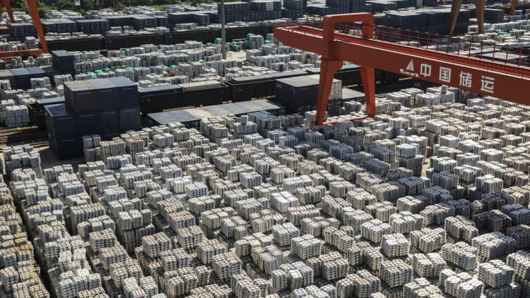 Bundles of aluminum ingots sit stacked at a China National Materials Storage and Transportation Corp. stockyard in Wuxi, China.