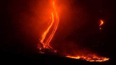 Mount Etna volcano spews lava during an eruption early on Christmas Day.