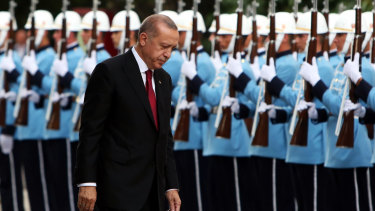 Amassing power: Recep Tayyip Erdogan, Turkey's President, inspects an honour guard after being sworn in under a new system of government at the Grand National Assembly of Turkey in Ankara.