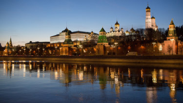 The Moskva River flows past the fortified outer walls of the Kremlin complex in Moscow, Russia.