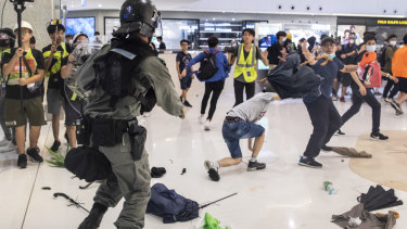 Riot police clashes with demonstrators inside New Town Plaza shopping mall in the Sha Tin district of Hong Kong, China.