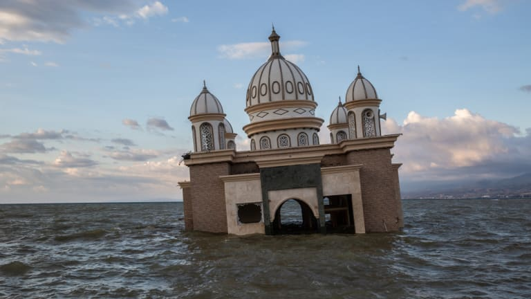 A mosque is surrounded by water in Palu, Central Sulawesi, on Tuesday after the earthquake and tsunami there.