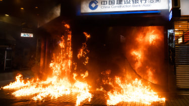 Demonstrators set fire to a China Construction Bank during a protest in the Causeway Bay of Hong Kong.