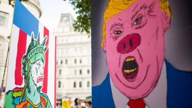 Demonstrators hold placards during a protest against Donald Trump in central London earlier this month.