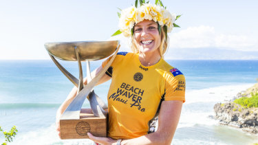 Spoils of victory: Stephanie Gilmore celebrates her record-equalling seventh world championship.