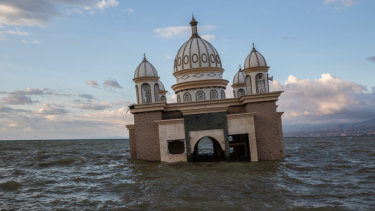 A mosque is surrounded by water in Palu, Central Sulawesi, on Tuesday after the earthquake and tsunami on October 9.