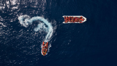People are rescued by the Spanish NGO Proactiva Open Arms, after leaving Libya trying to reach European soil aboard an overcrowded rubber boat last month.