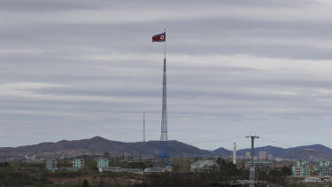 A North Korean flag flutters in the wind atop a 160-metre tower in North Korea.